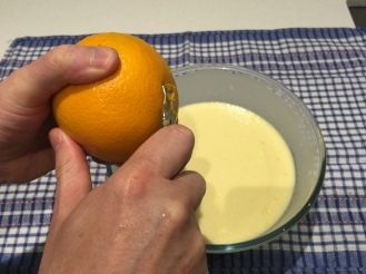Grate some lemon or orange zests