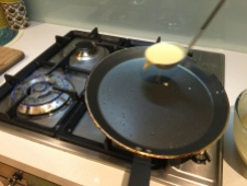 Scoop out a ladle of crepe mix