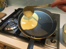 Pour it on one side of the crepe pan