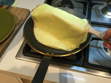 Place your spatula under the crepe
