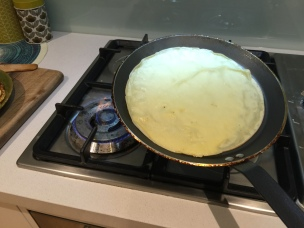 Now shake the pan in a forward backward motion to detach the crepe slightly