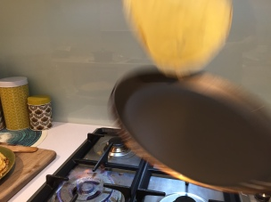 Then flick the pan with a firm upward rolling motion