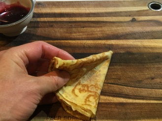 Pick the crepe with one hand
